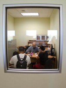 A young family interviews for assistance at a USDA food bank in San Antonio, TX. Photo via USDA.