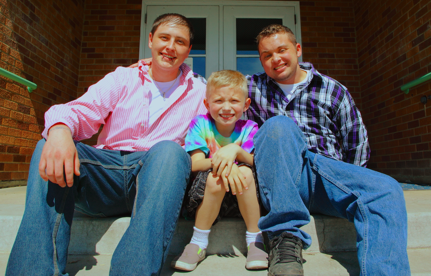 Utah couple Liam and Curtis pose with their son. Creative Commons photo by Sharon Mattheson-McCutcheon.