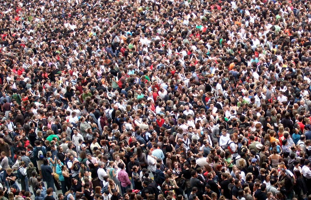 Photo of a large crowd of people, with no space in between.