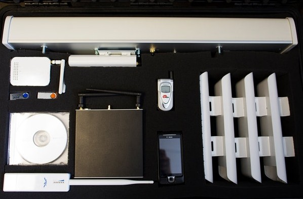 Contents of the suitcase include a cell phone, some antennae, and modems.