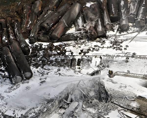 An entire train full of crude oil slides and tumbles 11 miles down hill. Image from NBCNews