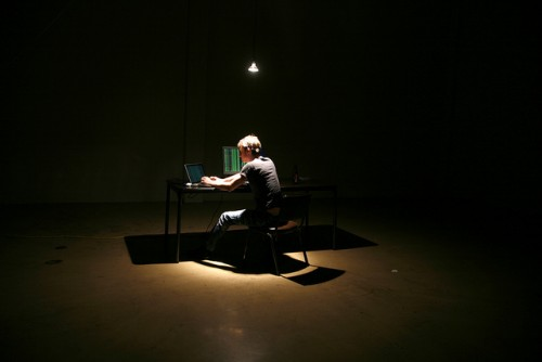 """Lone Hacker in Warehouse"" by Brian Klug"