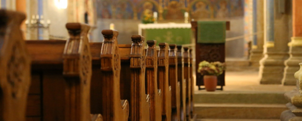 This image has an empty alt attribute; its file name is church-pews-600x240.png
