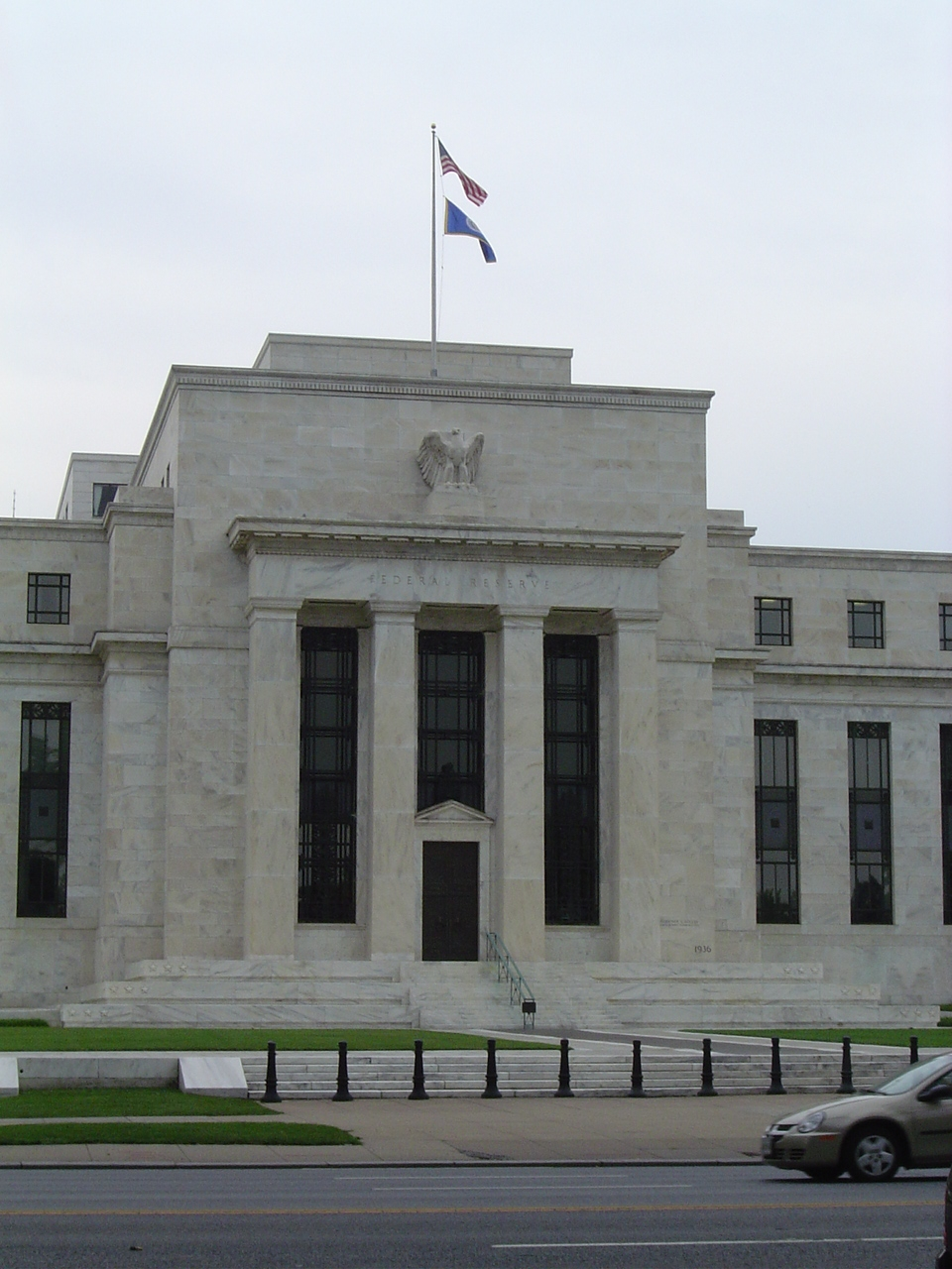 Here's the Federal Reserve building in Washington, DC; looks kind of like the Parthenon with a flag stuck on top where the Romans might have put a sculpture of the goddess.