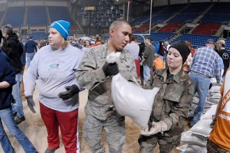 Soldiers and citizens work together to fight flooding in North Dakota. Photo by Master Sgt. David Lipp.