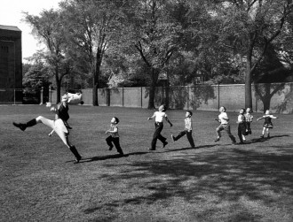 The U of Michigan drum major trailed by children across the quad. Photo from TIME LIFE, 1950. Click through for original.