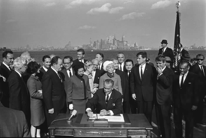 President Lyndon Baines Johnson signing the Immigration and Nationality Act of 1965 on Liberty Island (Lyndon B. Johnson Library Collection/Yoichi R. Okamoto)