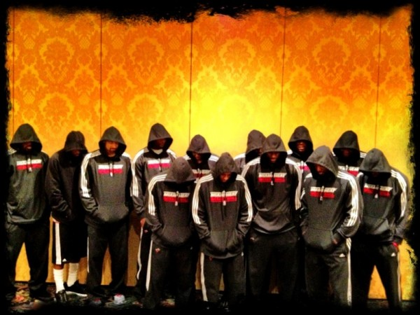 LeBron James and the Miami Heat in 2012, hoods raised and heads bowed in memory of Trayvon Martin.