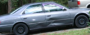 """My noticeable car (and this is the """"good side"""" (Photo courtesy of author)"""