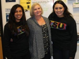 Donning their Latino/a Student Union shirts, Alejandra Pérez, Elizabeth Huffaker, and Jessica Velasquez