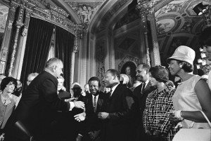 President Lyndon B. Johnson with the Rev. Dr. Martin Luther King, Jr. and Rosa Parks at the signing of the 1965 Voting Rights Act. (U.S. Government Photo)