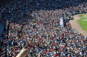 """The crowd joins in on the """"tomahawk chop"""" at an Atlanta Braves game. Photo by Kyle James via flickr.com."""