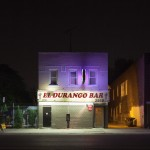 El Durango Bar lights up its block. © David Schalliol.