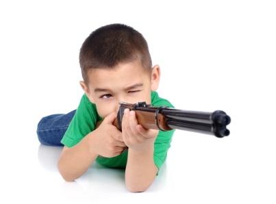 boy aiming a gun