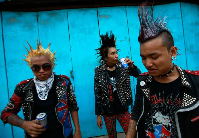Youths dressed as punks drink beer as they wait for a punk music show during the Myanmar New Year Water Festival in Yangon