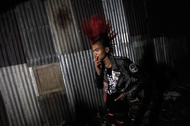 A punk smokes a cigarette at a punk music show in Yangon