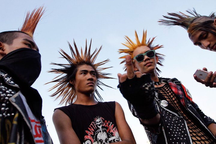 Young men attend a punk show during the water festival at a music bar in Yangon