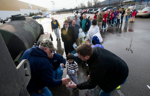 West Virginia citizens wait in line to retrieve clean water.