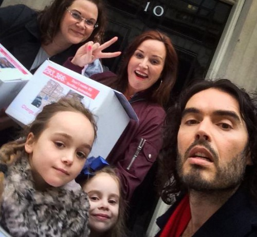 Russell Brand outside 10 Downing Street with New Era Estate residents.