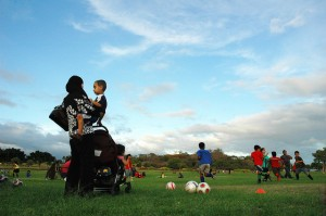 A Muslim American woman watches her child play soccer in Kapolei, Hawaii. Photo by Keoni Cabral via Flickr CC. Click for original.