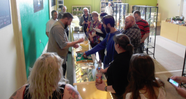 "Shoppers at North Bonneville, WA's ""Cannabis Corner,"" a municipally-owned retail marijuana shop. Image via TheCannabisCorner.org."