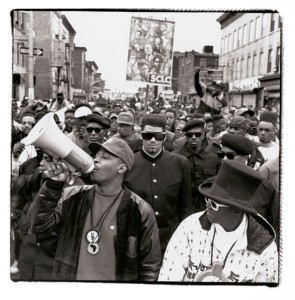 "A still from the Public Enemy video for ""Fight the Power."" Chuck D, holding the bullhorn, has since become an outspoken agitator and public figure working toward equality and political participation."