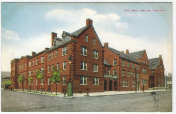 Postcard image shows a large brick building with many windows on a street corner. The top corner of the postcard reads, The Hull House, Chicago.