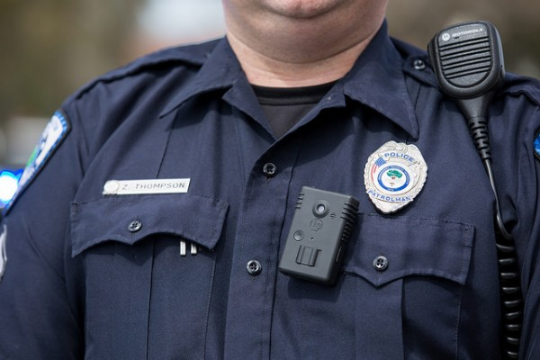 An officer wears a body camera in North Charleston, NC. Photo by Ryan Johnson, Flickr CC.