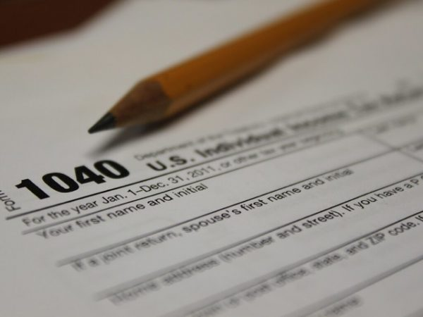 Photo of a 1040 tax form with a pencil.
