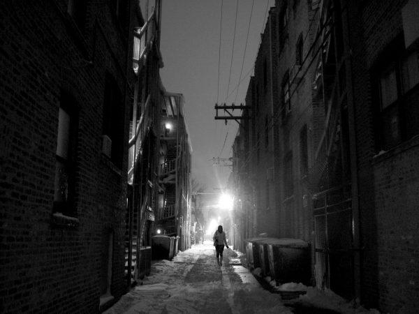 A woman walks alone in a dark alley. Photo by renee_mcgurk via Flickr.