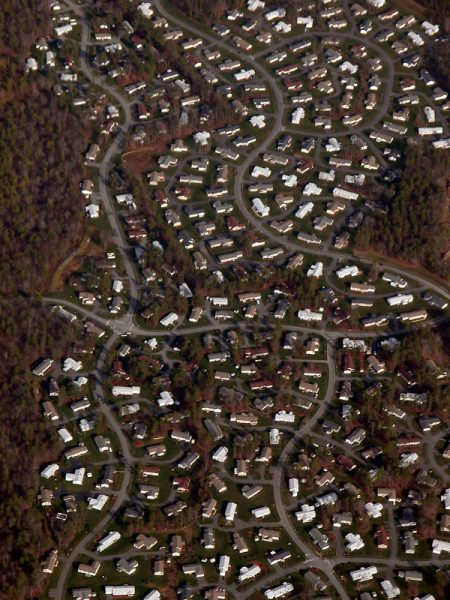 Image shows an aerial  view of a suburban community.